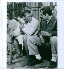 Stanley Kubrick and Kirk Douglas talk on the set of the film, Spartacus.