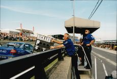 The Volvo team gives Rickard Rydell instructions through the pit board during the Brand Hatch competition.