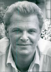Portrait of Peter Andersson smiling. 1988.
