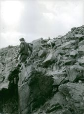 A local man from Yemen, walking on the rocky mountain.