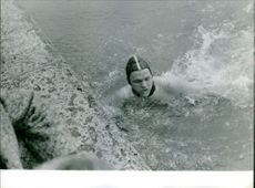 Donald Arthur Schollander swims