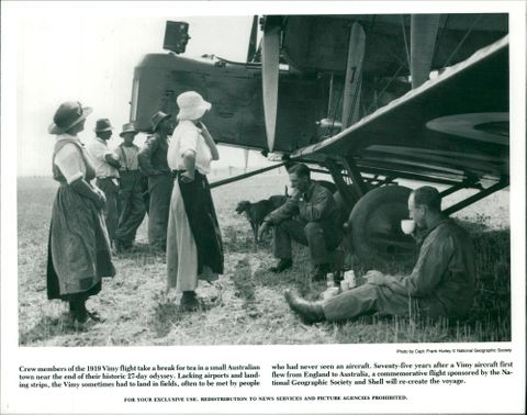Crew members of the 1919vimy light take a break for tea in a small australian.