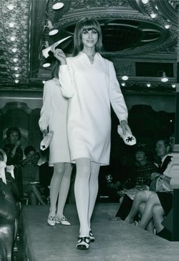 Models walking on the catwalk, wearing Katja of Sweden's collection. 1966.