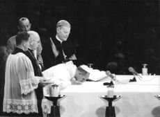 Pope Paul VI bowing down, performing a mass.  Taken - Oct 1965