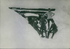 Soldiers relaxing on the snow.