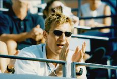 Sergei Fedorov looks at when girlfriend Anna Kournikova plays at Flushing Meadows in the US Open