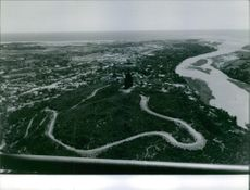"""High angle view of a city in Vietnam.  """" __ in Vietnam.""""  1962"""