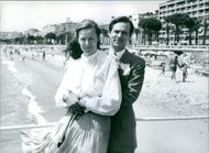 Hon. John Jacob Astor, elder son and heir of Baron Astor of Hever, with his wife Fiona, photograph on the seafront at Cannes. The couple have three daughters John Astor was given the family seat, Hever Castle, in trust in 1974, but put it on the market in