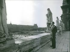 Valery Marie Rene Georges Giscard d'Estaing standing on the roof of government building.