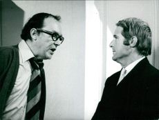 Eric Morecambe and Ernie Wise communicating with each other.