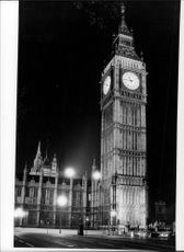 Black and white photograph on the famous belltower Big Ben in London. Photographed during the evening.