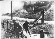 Two soldiers running away from the blast.