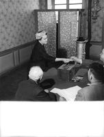 Charles André Joseph Marie de Gaulle sitting on floor.