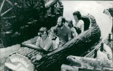 Simpson Family on a theme park ride while vacationing in Germany.