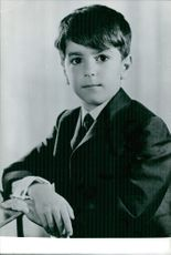 Year ? Portrait of a young boy on his suit.