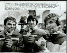 Steve Podborski, Leonard Stock and Peter Wirnsberger show off their medals in downhill skiing during the 1980 Winter Olympics
